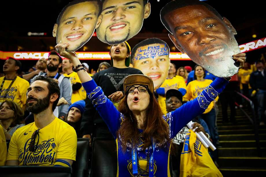 FILE – Golden State Warriors fan Teresa Wolf cheers during Game 3 of the Western Conference Finals between the Warriors and the Houston Rockets at Oracle Arena in this May 20, 2018 file photo taken in Oakland. Fans took to Twitter on the eve of the Warriors' last game at Oracle Arena to share their memories of the arena, which has been the Warriors' home for 47 seasons.  Click or swipe through to see Warriors' greatest memories and moments at Oracle Arena. >>> Photo: Gabrielle Lurie, The Chronicle