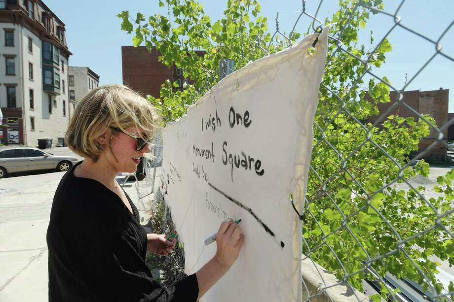 Liz Comitale, manager of Troy Farmers Market, writes farmer's market on a piece of fabric at the 1 Monument Square site on Tuesday, June 12, 2018, in Troy, N.Y. The fabric is hanging at the site for people to write their ideas on what they would like to see built at the site.   (Paul Buckowski/Times Union) Photo: Paul Buckowski, Albany Times Union / (Paul Buckowski/Times Union)