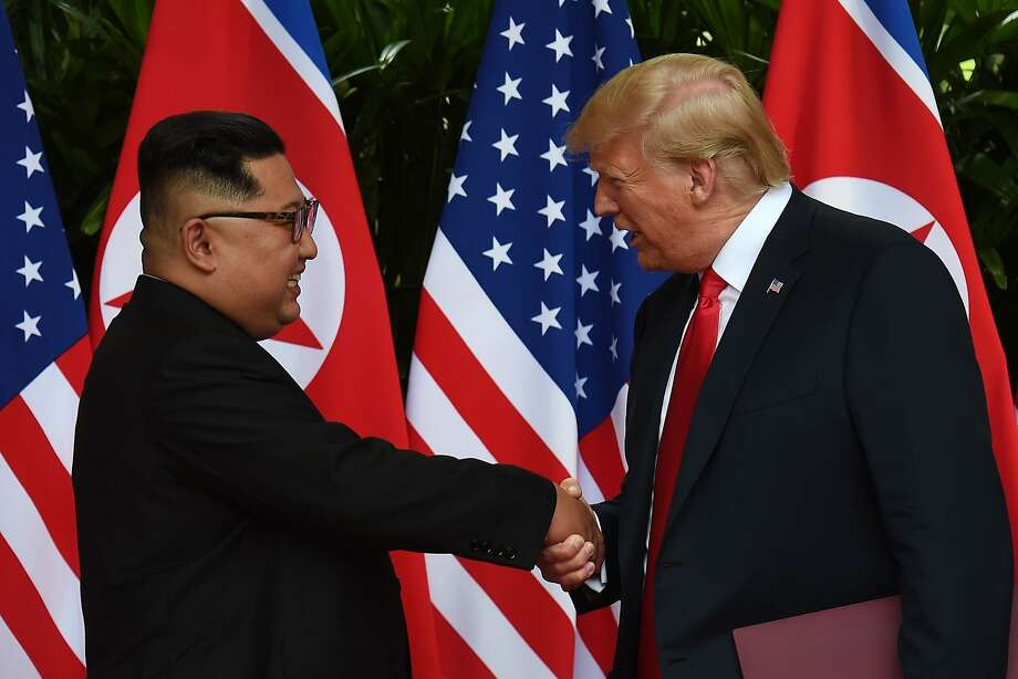 North Korea's leader Kim Jong Un (L) shakes hands with US President Donald Trump (R) after taking part in a signing ceremony at the end of their historic US-North Korea summit, at the Capella Hotel on Sentosa island in Singapore on June 12, 2018. Donald Trump and Kim Jong Un became on June 12 the first sitting US and North Korean leaders to meet, shake hands and negotiate to end a decades-old nuclear stand-off.  Photo: ANTHONY WALLACE, AFP/Getty Images