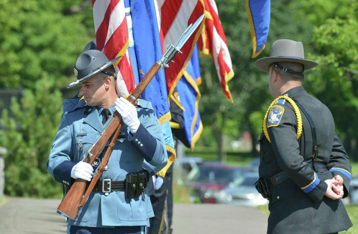 Color Guards from all over the state and out of state make their way into the funeral service for Connecticut State Trooper First Class Walter Greene Jr. at Sherwood Island State Park on Tuesday June 12, 2018 in Westport Conn.