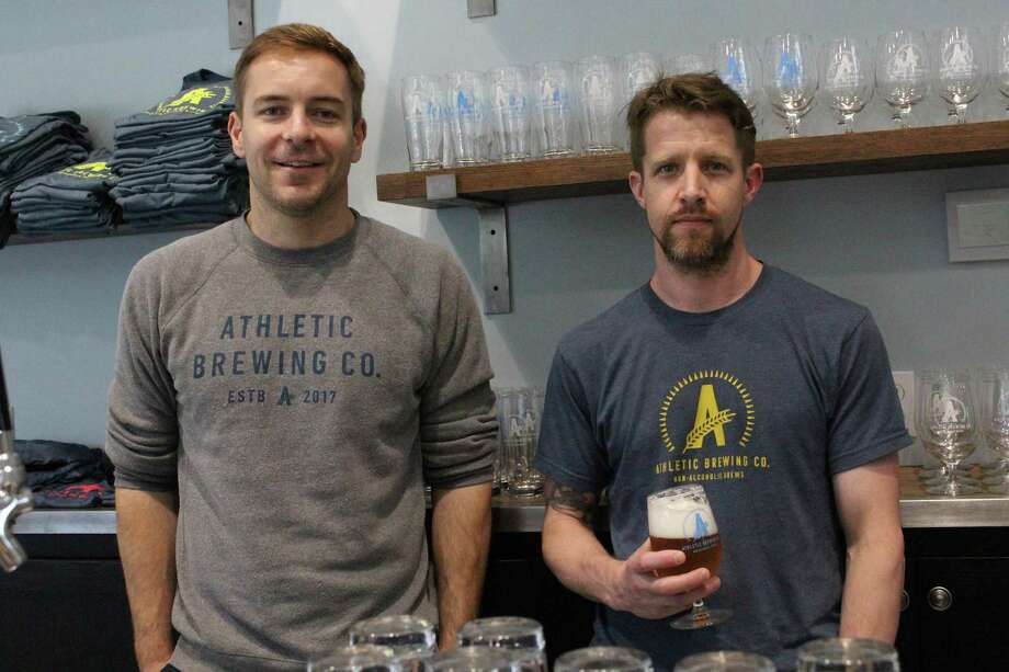 (Left to right) Owners of Athletic Brewing Company, Bill Shufelt and John Walker, opened their non-alcoholic brewery a month ago and have hit the ground running with their two flagship brews. Photo: Jordan Grice / Hearst Connecticut Media / Connecticut Post