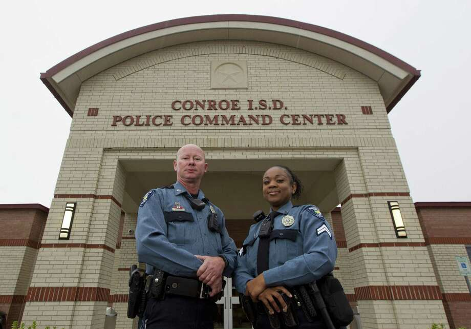 Conroe ISD Police Officer Fred Whiteside, left, and Corporal Brandy Walker pose for a portrait outside the district's police command center in 2017. Photo: Jason Fochtman, Staff Photographer / Houston Chronicle / © 2017 Houston Chronicle