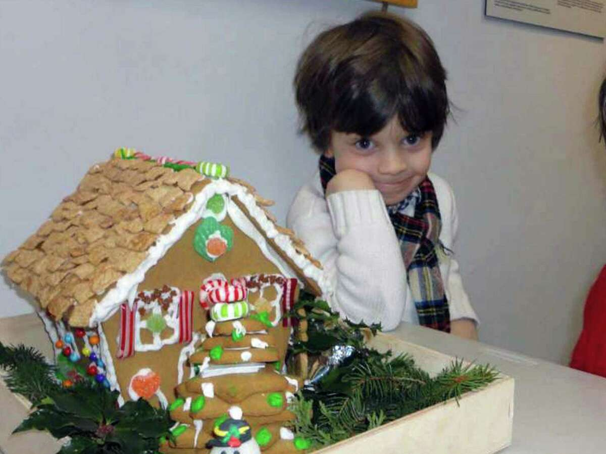 Perrin Delorey, photographed here at age 4, poses with a gingerbread house decorated for the Westport-Weston Chamber of Commerce's contest in 2012. The 10-year-old boy died Monday, June 11, 2018, after being severely injured in a car crash the day before in Sharon, N.Y.