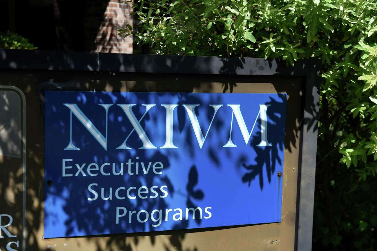 Exterior sign at the NXIVM offices on New Karner Rd. on Tuesday, June 12, 2018, in Colonie, N.Y. NXIVM announced it was suspending all operations and planned events. (Will Waldron/Times Union)
