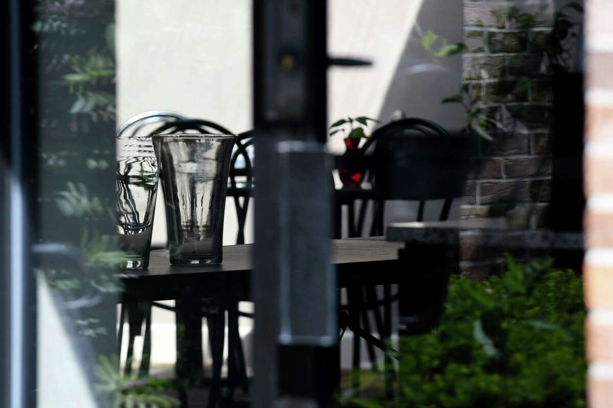 View looking through a window into the NXIVM offices on New Karner Rd. on Tuesday, June 12, 2018, in Colonie, N.Y. NXIVM announced it was suspending all operations and planned events. (Will Waldron/Times Union)
