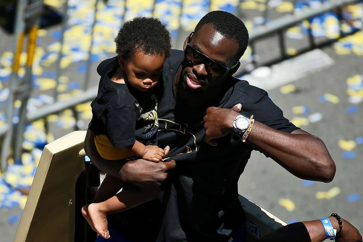 Golden State Warriors forward Draymond Green with his son Draymond Jamal Green during the Golden State Warriors Championship Parade, Tuesday, June 12, 2018, in Oakland, Calif.