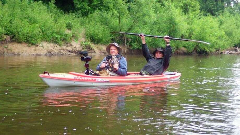 The 'camera crew' featuring cameraman John Scollon in the front and seasoned riverman Russ Fall of Millington paddling from the back, in a two-person kayak furnished by Frankenmuth Kayak Adventures. (Tom Lounsbury/for Hearst Michigan)