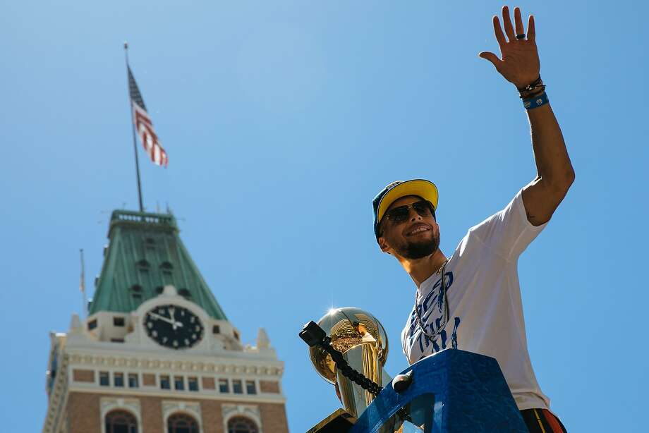 Steph Curry waves to thousands of Warriors fans during the Warriors Championship Parade in downtown Oakland, Calif., Tuesday, June 12, 2018. After making some curious comments on a recent podcast, Steph Curry now says he really does believe that NASA has sent people to the moon.   Photo: Mason Trinca / Special To The Chronicle
