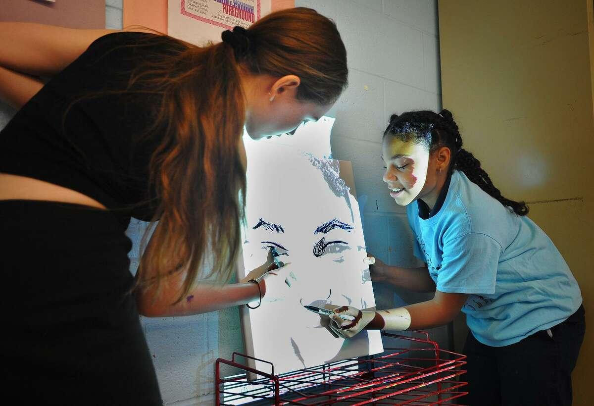 Turnaround Arts program artist Autumn DeForest, of Las Vegas, Nevada, helps 6th grader Tamara Hamilton, 12, make a self portrait during a visit to Hallen School in Bridgeport, Conn. on Tuesday, June 12, 2018.