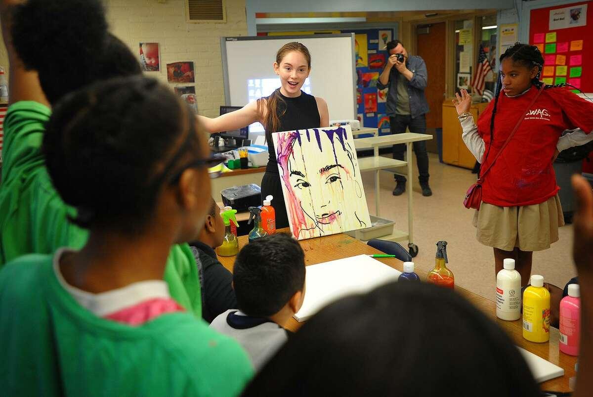 Turnaround Arts program artist Autumn DeForest, of Las Vegas, Nevada, teaches students to do self portraits during a visit to Hallen School in Bridgeport, Conn. on Tuesday, June 12, 2018.