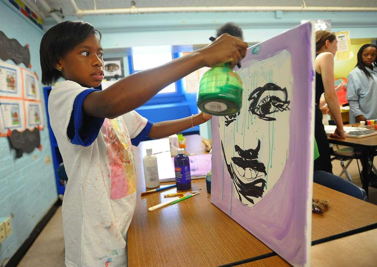 Sixth grader Casondra Caldwell, 11, works on her self portrait during a visit by Turnaround Arts program artist Autumn DeForest at Hallen School in Bridgeport, Conn. on Tuesday, June 12, 2018.