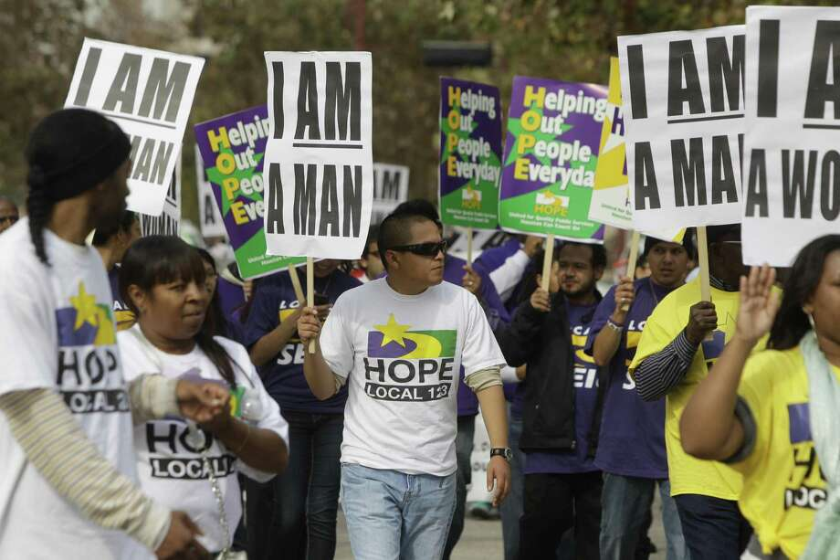 Members of Houston Organization of Public Employees Local 123 march in a parade honoring Martin Luther King Jr. in Houston. ( Melissa Phillip / Houston Chronicle ) Photo: Melissa Phillip, Staff / Houston Chronicle / © 2013 Houston Chronicle