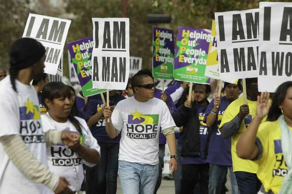 Members of Houston Organization of Public Employees Local 123 march in a parade honoring Martin Luther King Jr. in Houston. ( Melissa Phillip / Houston Chronicle )