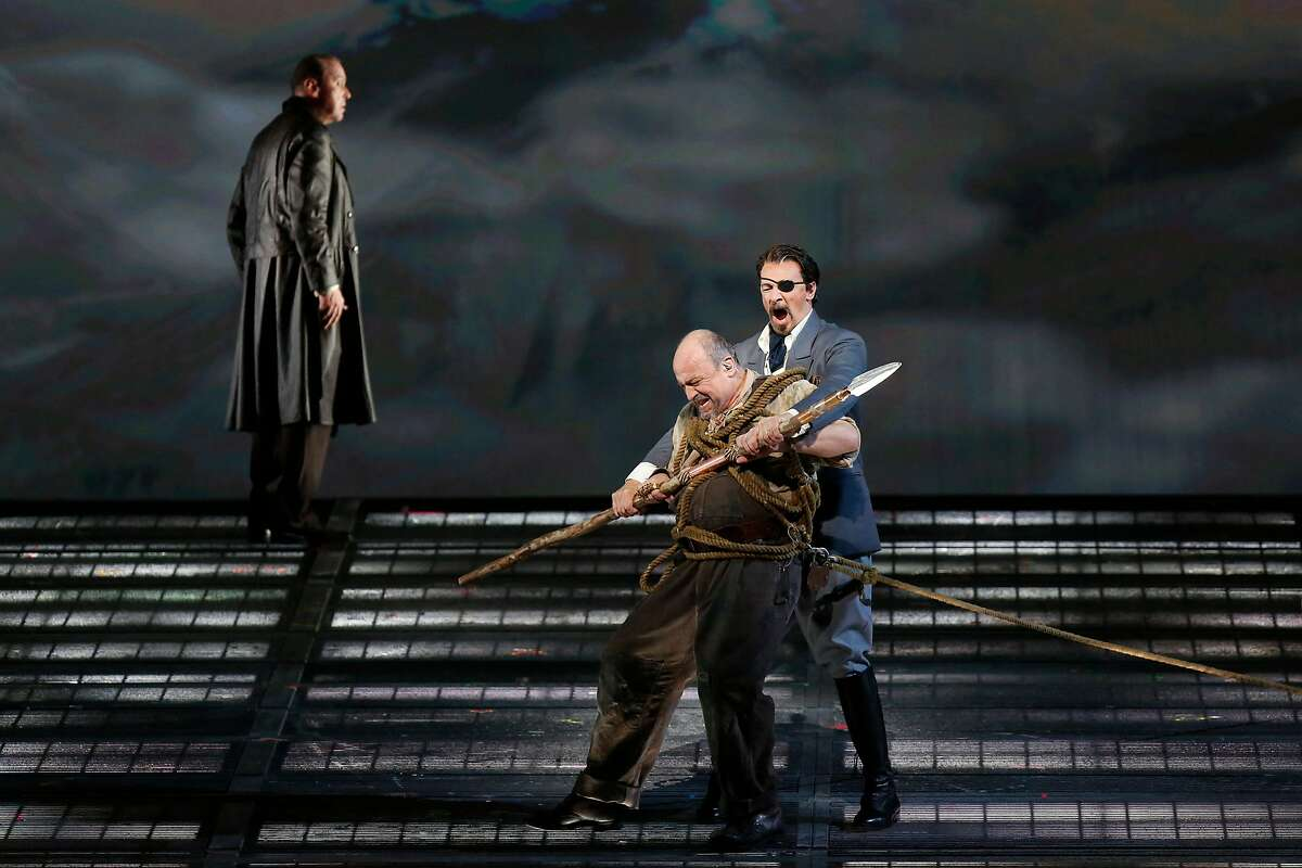 "Wotan (Greer Grimsley) holds Alberich (Falk Struckmann) in a lock while Loge (�tefan Margita) looks on during the final dress rehearsal of ""Das Rheingold"" at the San Francisco Opera on Wednesday, June 6, 2018 in San Francisco, Calif."