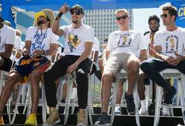 (From left) Warriors' Stephen Curry, Klay Thompson, Head Coach Steve Kerr and General Manager Bob Myers sit down for an NBC Bay Area Sports question and answer session with the team and coaches before the start of the Golden State Warriors NBA Finals victory parade in downtown Oakland, Calif. Tuesday, June 12, 2018.