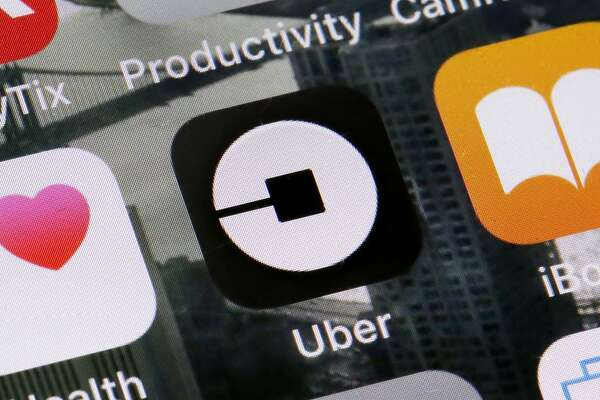 The Uber app is shown on a phone in New York, Tuesday, June 12, 2018. The CEO of Uber, Dara Khosrowshahi, says New York City should impose a fee on app-hailed rides to help taxi medallion owners who are struggling with debt. (AP Photo/Richard Drew)