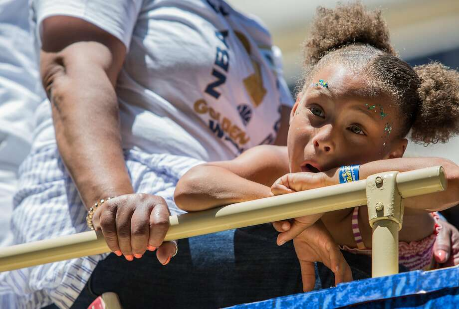 FILE – Riley Curry, daughter of Warriors' Stephen Curry, interacts with fans while riding on a bus during the Golden State Warriors NBA Finals Championship parade in downtown Oakland in this Tuesday, June 12, 2018 file photo. A video of Riley dancing at the Warriors' final preseason game went viral.