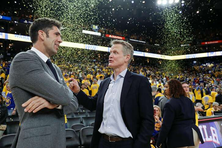Golden State Warriors' Bob Myers and head coach Steve Kerr talk after the Warriors defeated the New Orleans Pelicans 113 to 104 in 5 of the Western Conference Semifinals at Oracle Arena on Tuesday, May 8, 2018 in Oakland, Calif.