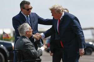 President Donald Trump meets with Senator Ted Cruz, top left, and Governor Greg Abbott after landing at Ellington Field Joint Reserve Base Thursday, May 31, 2018 in Houston. Trump is scheduled to meet with those affected by the Santa Fe High School Shooting before attending a fundraiser. (Michael Ciaglo / Houston Chronicle)