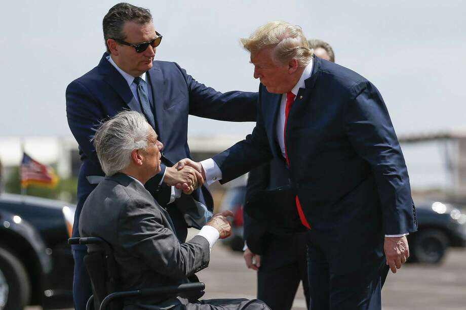 President Donald Trump meets with Senator Ted Cruz, top left, and Governor Greg Abbott after landing at Ellington Field Joint Reserve Base Thursday, May 31, 2018 in Houston. Trump is scheduled to meet with those affected by the Santa Fe High School Shooting before attending a fundraiser. (Michael Ciaglo / Houston Chronicle) Photo: Michael Ciaglo,  Staff Photographer / Houston Chronicle / Michael Ciaglo