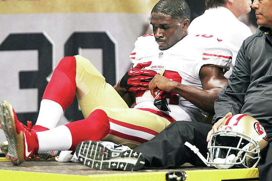 San Francisco's Reggie Busch is taken off the field after suffering an injury at the former Edward Jones Dome in a game against the then-St. Louis Rams in 2015. Tuesday, a St. Louis jury awarded Bush $12.5 million for a severe knee injury on the play. Photo:       Bill Greenblatt, UPI File Photo | For The Telegraph