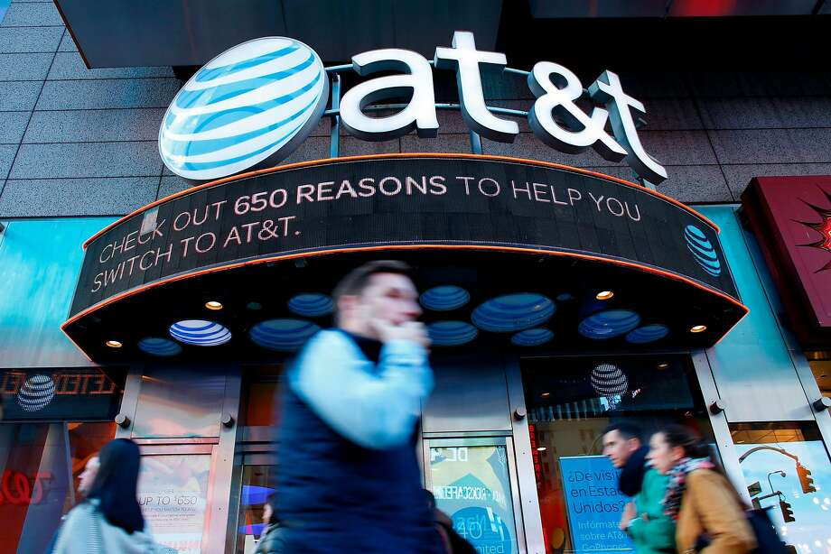 AT&T will take over Time Warner, a move that is expected to unleash a wave of corporate mergers. Photo: Kena Betancur / AFP / Getty Images 2016