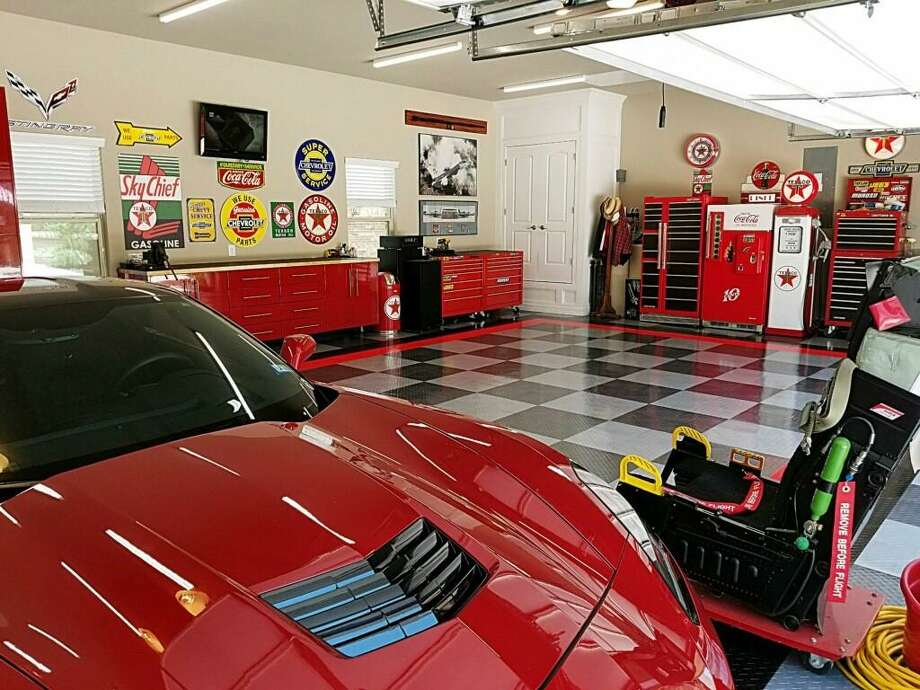 In designing this tricked-out garage in his new home in Fair Oaks, retired Air Force Master Sergeant Ed Hobbs wanted a look that would show off his red 2015 Corvette Stingray. The concept was designed by Premier Garage. Photo: Courtesy Ed Hobbs