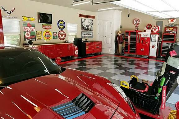 In designing this tricked-out garage in his new home in Fair Oaks, retired Air Force Master Sergeant Ed Hobbs wanted a look that would show off his red 2015 Corvette Stingray. The concept was designed by Premier Garage.