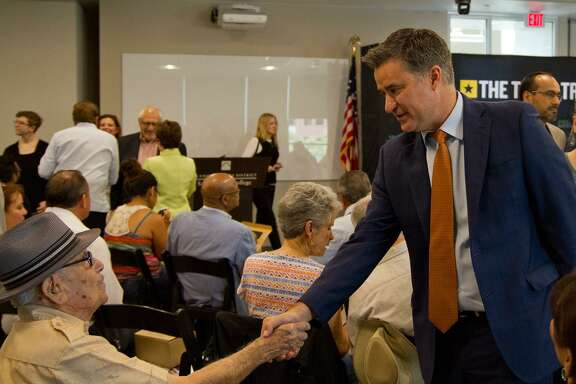 State Rep. Roland Gutierrez shaking hands with Jesse Vidales before a conversation with Texas Tribune CEO Evan Smith and fellow legislators at San Antonio College June 12. He is the Editorial Board pick in Senate District 19.