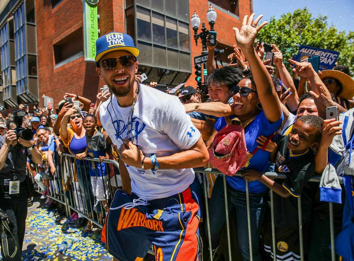 Stephen Curry greets the crowd during the Warriors Championship Parade in Oakland, California, on Tuesday, June 12, 2018.