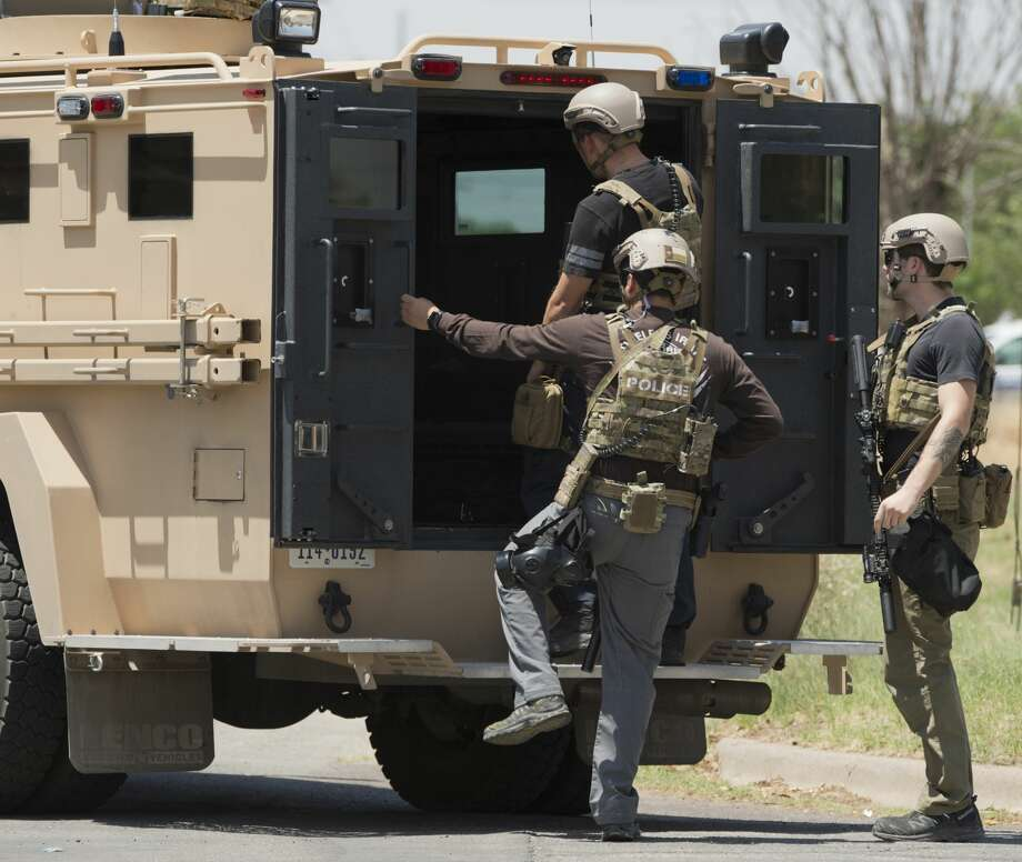 Midland Police and SWAT respond 06/12/18 afternoon to a residence on the corner of Hamby and Keith St. where a resident refused to come out. Police fired multiple rounds of tear gas into the home before the subject surrendered.  Tim Fischer/Reporter-Telegram Photo: Tim Fischer/Midland Reporter-Telegram