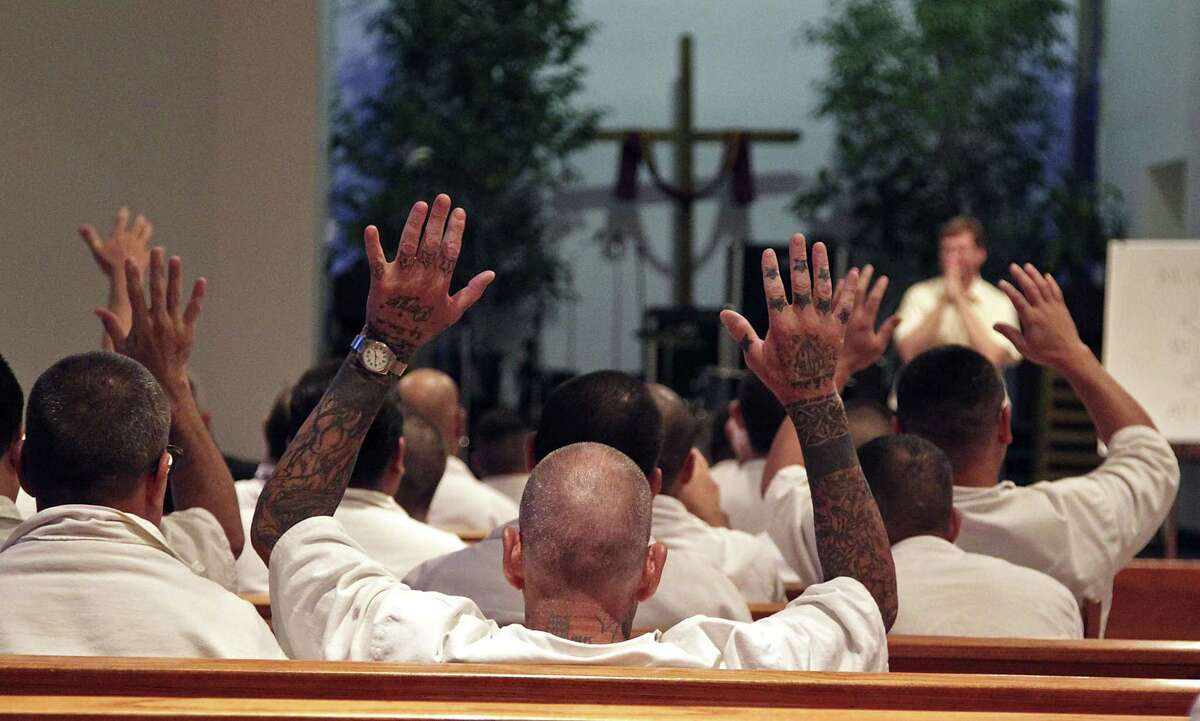 """Prison inmates in the chapel during Woodhaven Baptist Deaf Church Prison Ministry sermon at Texas Department of Criminal Justice's W. J. """"Jim"""" Estelle Unit Thursday, June 12, 2014, in Riverside."""