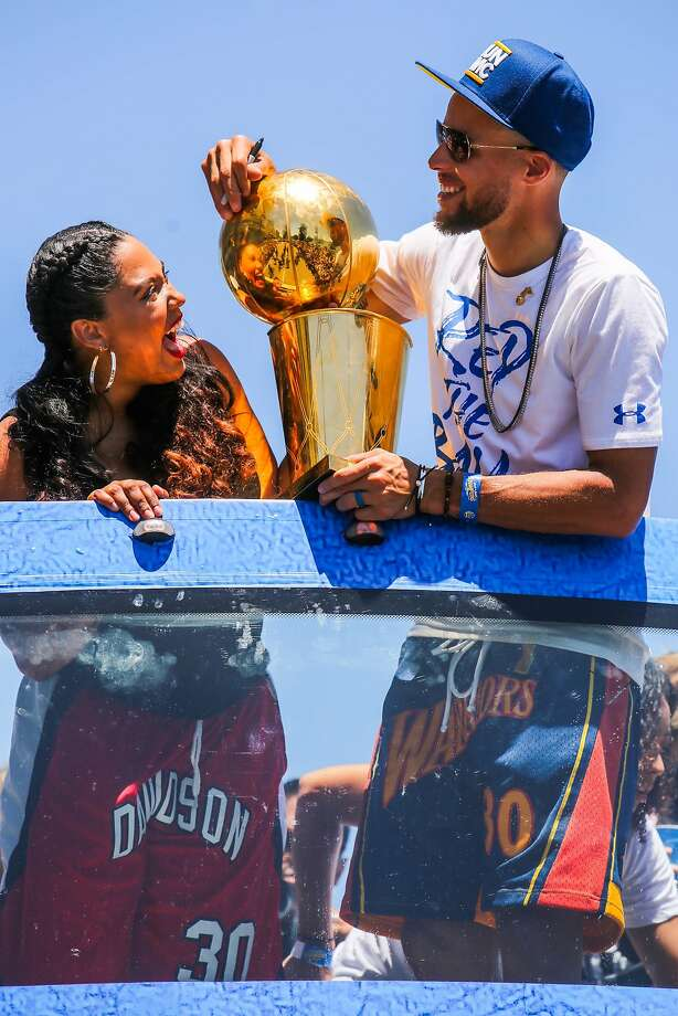 Stephen Curry and wife Ayesha Curry share a laugh during the Warriors Championship Parade in Oakland, California, on Tuesday, June 12, 2018. Photo: Gabrielle Lurie / The Chronicle