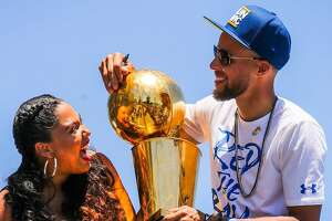 bb71aa73e11e Stephen Curry and wife Ayesha Curry share a laugh during the Warriors  Championship Parade in Oakland