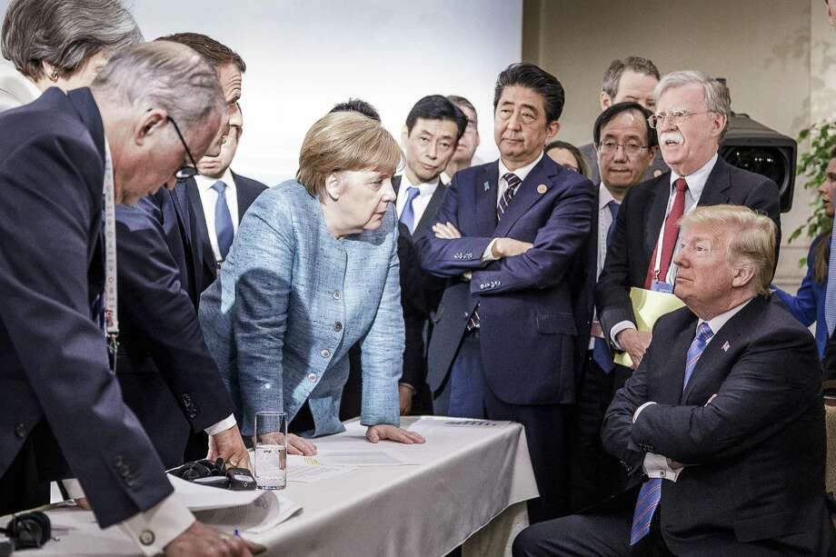 German Chancellor Angela Merkel — along with other world leaders — deliberates with President Donald Trump on the sidelines of the official agenda on the second day of the G7 summit on Saturday in Charlevoix, Canada. Photo: Handout /Getty Images / 2018 BPA