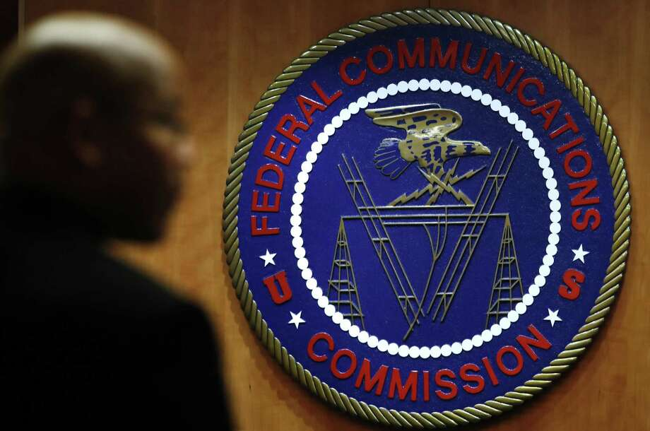 This Dec. 14, 2017, file photo, shows the seal of the Federal Communications Commission before a meeting in Washington. Your ability to watch and use your favorite apps and services could start to change, though not right away, following a formal repeal of Obama-era internet protections on Monday, June 11, 2018. The repeal takes effect six months after the FCC voted to undo net neutrality rules that had barred broadband and cellphone companies from favoring their own services and discriminating against rivals such as Netflix. Photo: Jacquelyn Martin /Associated Press / Copyright 2017 The Associated Press. All rights reserved.