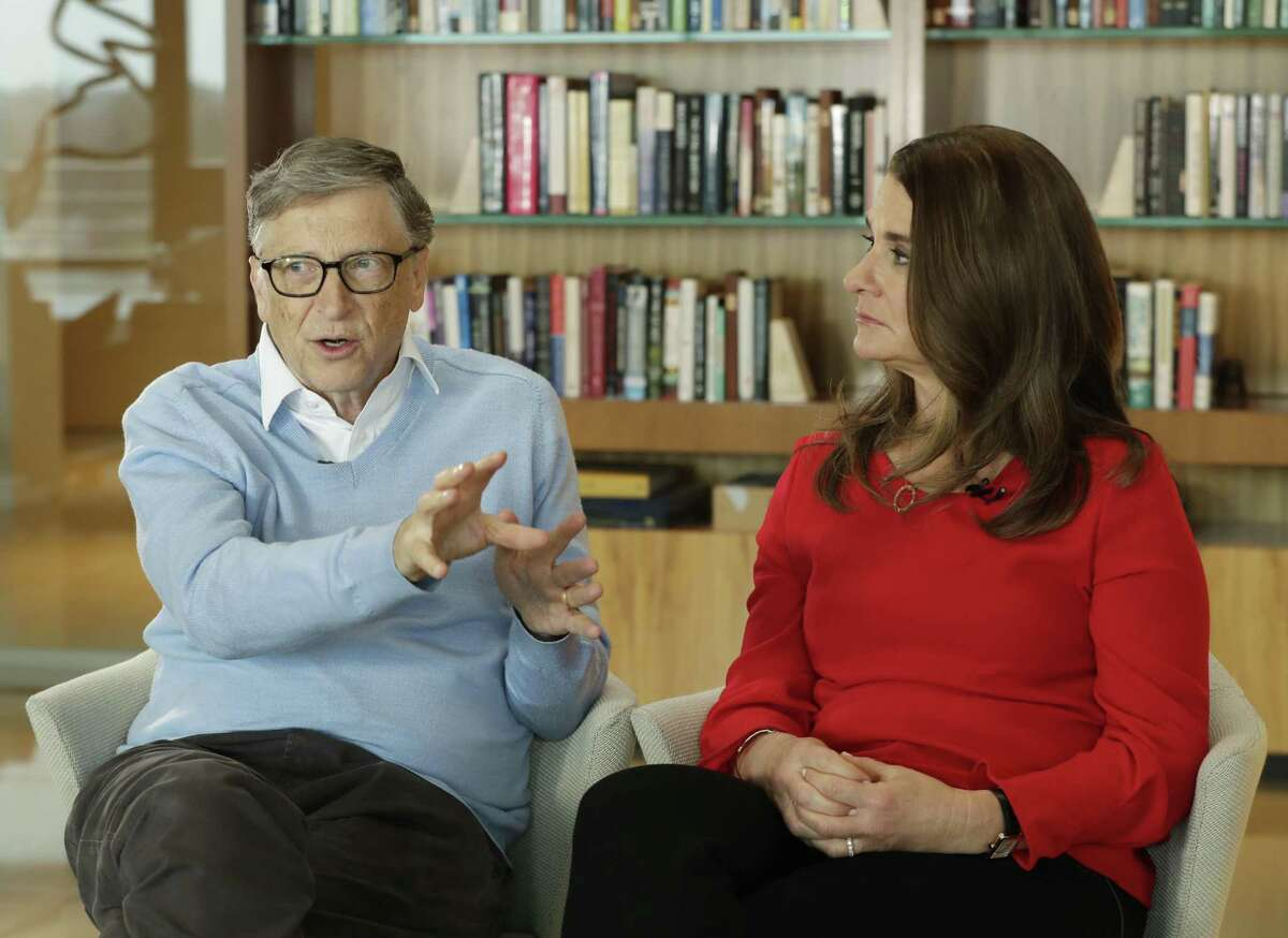 Microsoft co-founder Bill Gates and his wife Melinda take part in an AP interview in Kirkland, Wash. on Feb. 1, 2018. Gates' non-profit Bill and Melinda Gates Foundation has given about $44 million to outside groups over the past two years to help shape new state education plans required under the 2015 law, according to an Associated Press 2018 analysis of its grants.