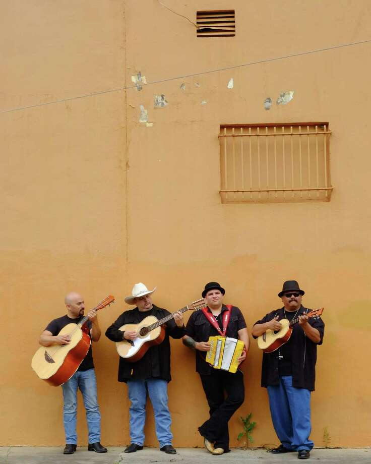 Los Texmaniacs is a conjunto band from San Antonio led by Max Baca, second from left. The group also features Josh Baca (accordion), multi-instrumentalist Lorenzo Martinez (far right) and Noel Hernandez (far left). Photo: Michael G. Stewart / Michael G. Stewart