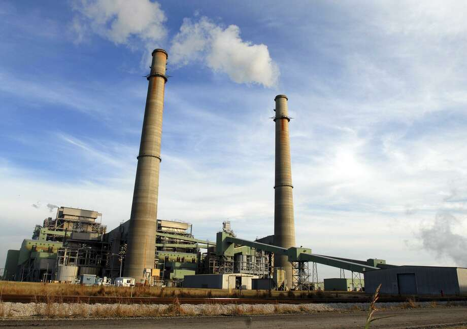 Smoke stacks from the NRG cola-fired power plant located just outside of Jewett, Texas. Photo: Nick Simonite, STR / AP / AP