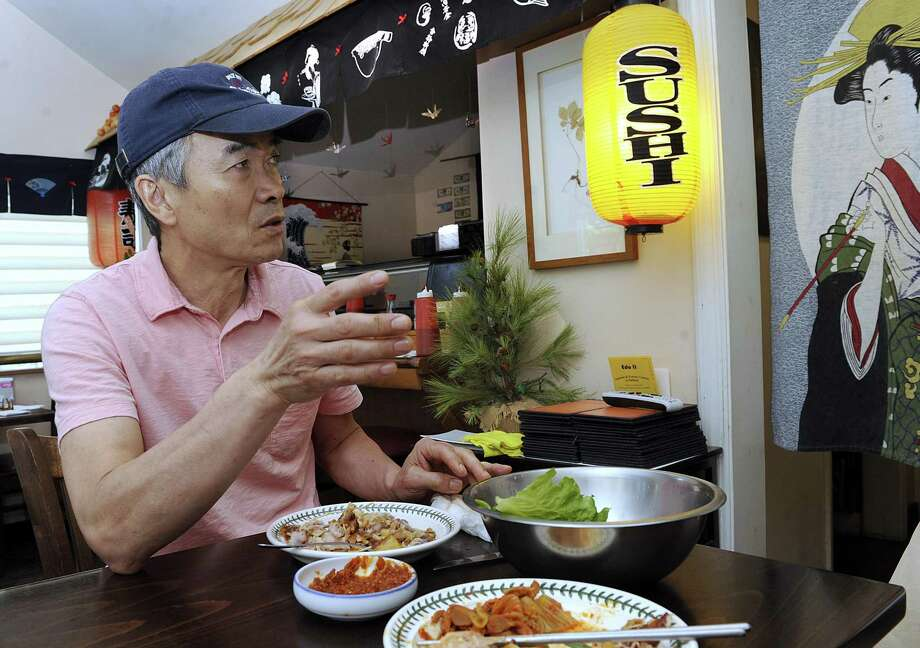 Jay Lim, 62, owner of Edo II in Danbury, a restaurant that serves Korean and Japanese food, weighs in Tuesday, June 12, 2018, on the Trump-Kim summit. Lim is an immigrant from South Korea. Photo: Carol Kaliff / Hearst Connecticut Media / The News-Times