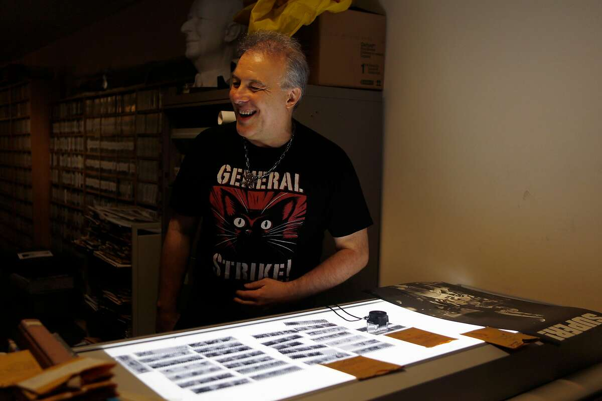 Jello Biafra reacts to looking at old negatives of himself at the San Francisco Chronicle before appearing on The Big Event podcast on Monday, June 11, 2018 in San Francisco, Calif. He is celebrating his 60th birthday with a Great American Music Hall show on Sunday.