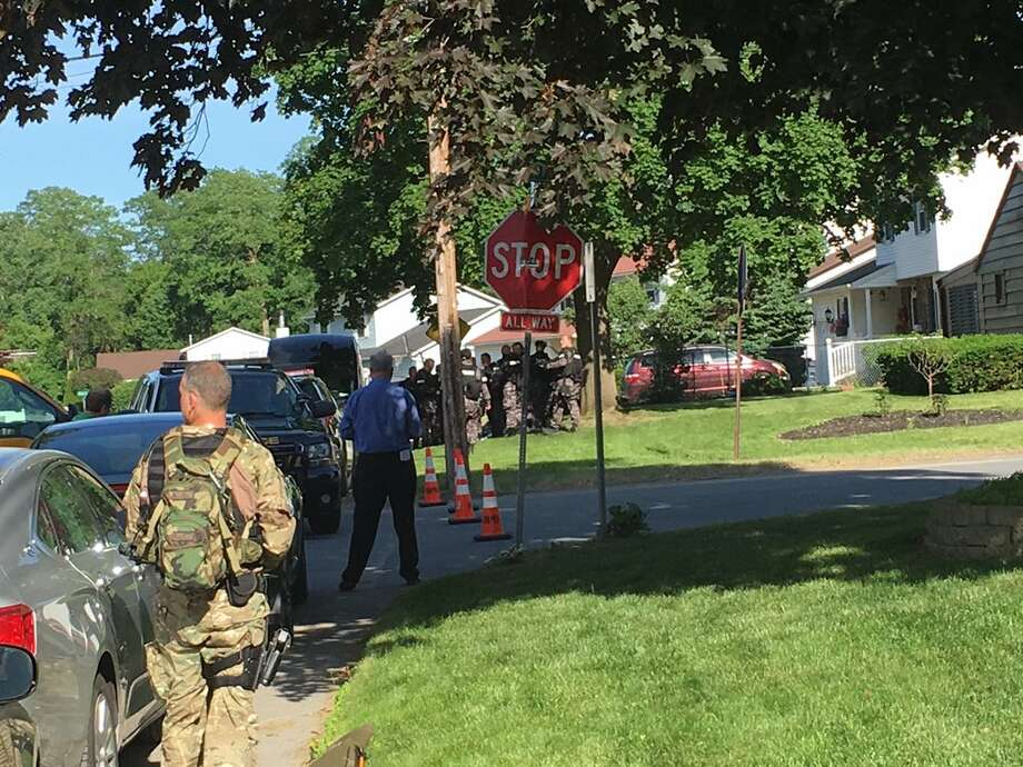 Police surround a home in Rotterdam, N.Y., after a man allegedly shot his neighbor in the abdomen with a BB gun and then barricaded himself in his residence on Tuesday, June 12, 2018. Photo: Paul Nelson / Times Union