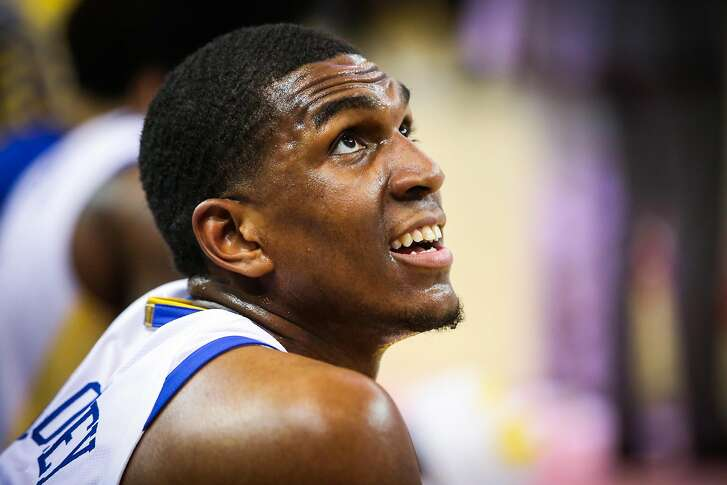 Kevon Looney (5) sits on the sideline during a timeout in Game 1 of the The NBA Finals between the Golden State Warriors and the Cleveland Cavaliers in Oakland, California, on Thursday, May 31, 2018.