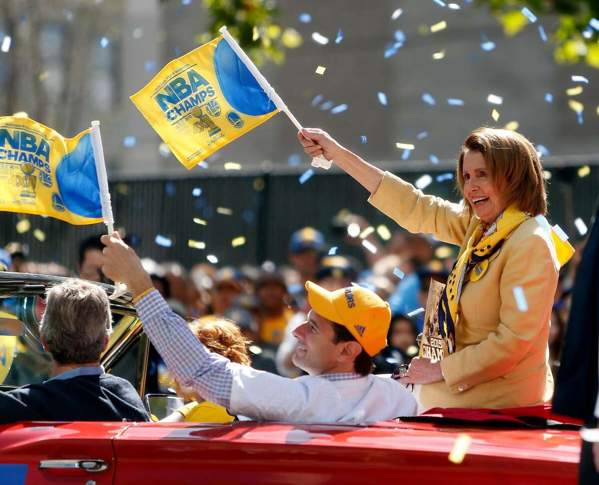 FILE-- Nancy Pelosi during Golden State Warriors' victory parade down Broadway in Oakland on Friday, June 19, 2015.