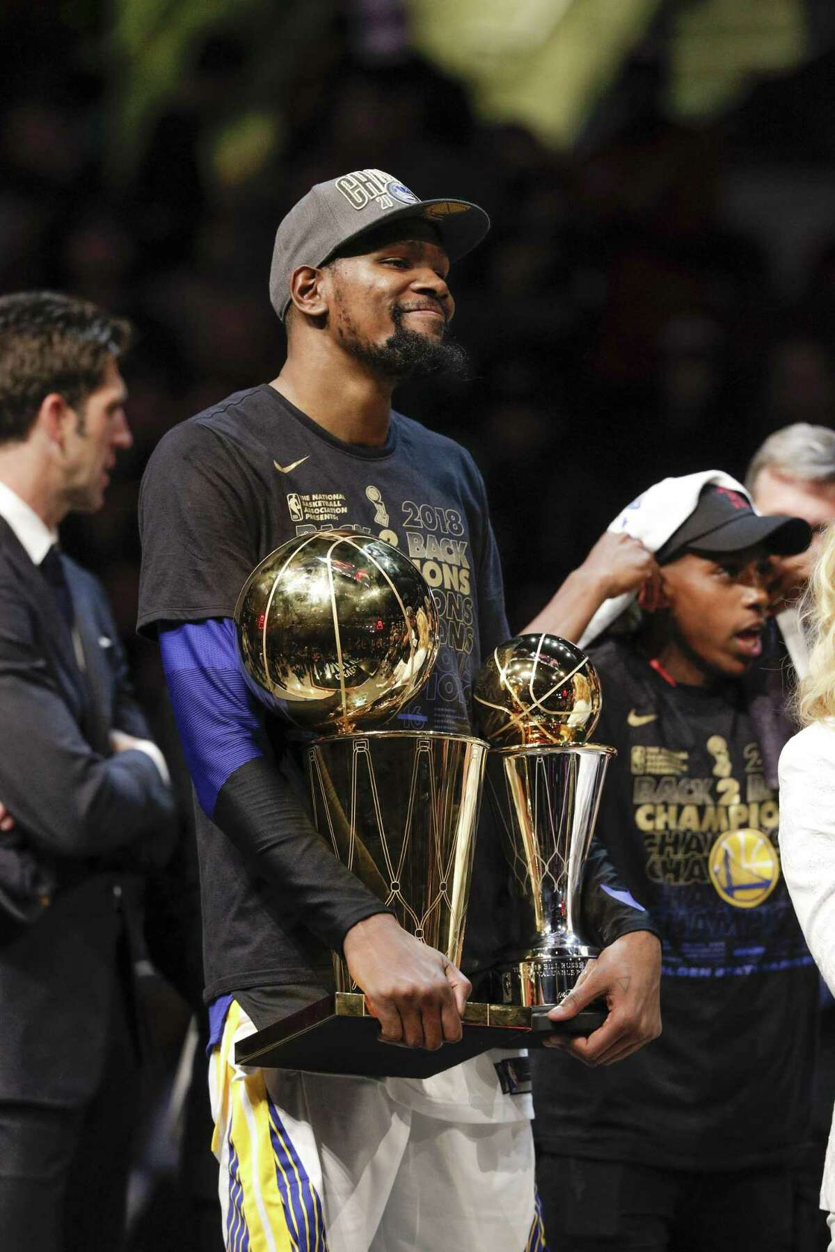 Golden State Warriors' Kevin Durant holds the the Larry OíBrien NBA Championship Trophy and The Bill Russell MVP Award after game 4 of The NBA Finals between the Golden State Warriors and the Cleveland Cavaliers at Quicken Loans Arena on Friday, June 8, 2018 in Cleveland, Ohio.