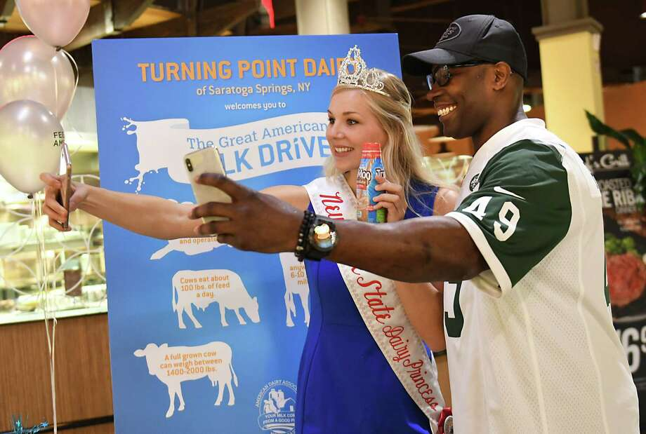 Hailey Pipher, NYS Dairy Princess 2018-2019, and NY Jets Alumni Tony Richardson take selfies at Market Bistro on Tuesday, June 12, 2018 in Latham, N.Y. NY State Agriculture Commissioner and Price Chopper/Market 32 join The Great American Milk Drive to bring milk to Capital District families. Price Chopper/Market 32 is helping Feeding America  deliver fresh milk to help fuel summertime for local kids in need. (Lori Van Buren/Times Union) Photo: Lori Van Buren / 40044051A