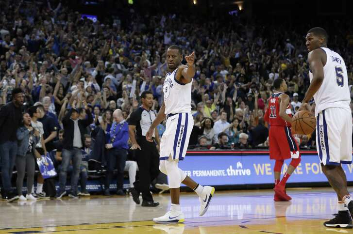 Warriors Andre Iguodala gestures to his teammates in the second half, as the Golden State Warriors went on to beat the Washington Wizards 120-117 in NBA action at Oracle Arena in Oakland, Ca. on Friday October 27, 2017.