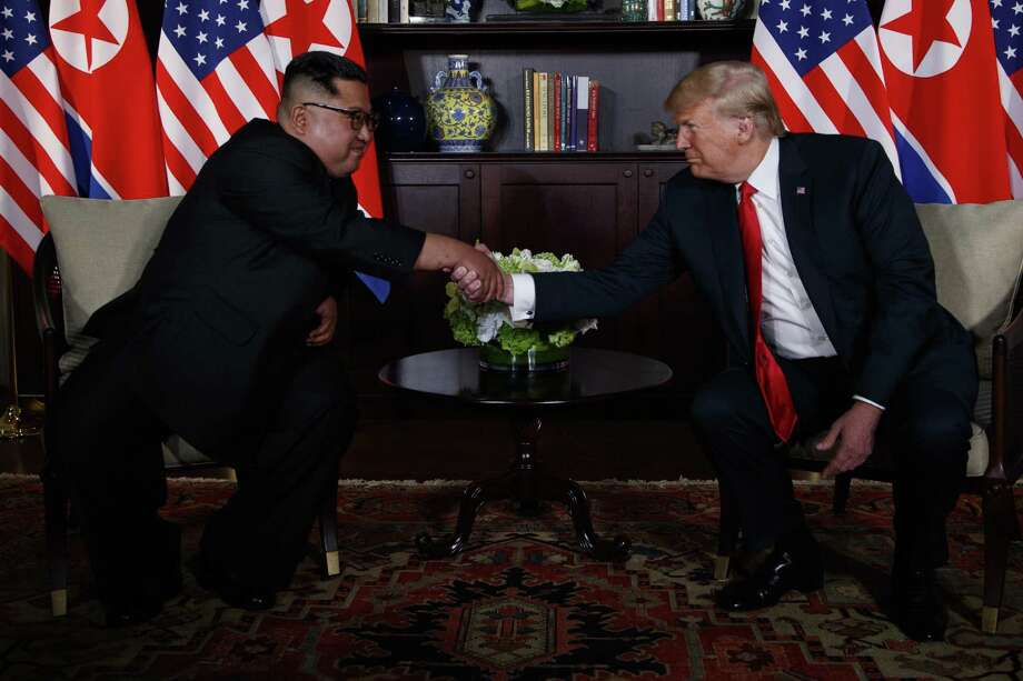 President Donald Trump meets with North Korean leader Kim Jong Un on Sentosa Island, Tuesday, June 12, 2018, in Singapore. Photo: Evan Vucci, STF / Associated Press / Copyright 2018 The Associated Press. All rights reserved.