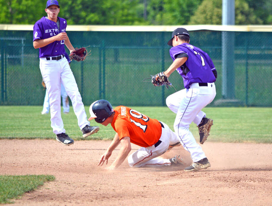 Edwardsville's Aaron Young steals second base during the first inning of Tuesday's game against Extreme Elite 16U at Tom Pile Field.