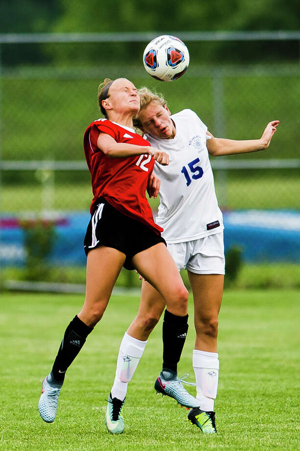 Midland junior Samantha Vansumeren jumps up for a header during the Chemics' 1-0 Division 1 semifinal loss to Grand Blanc on Tuesday, June 12, 2018 at Holt High School. (Katy Kildee/kkildee@mdn.net) Photo: (Katy Kildee/kkildee@mdn.net)